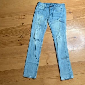 American Eagle distressed light wash skinny jeans